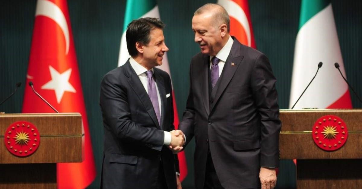 President Recep Tayyip Erdou011fan shakes hand with Italian Prime Minister Giuseppe Conte, Ankara, Jan.13, 2020. (IHA Photo)