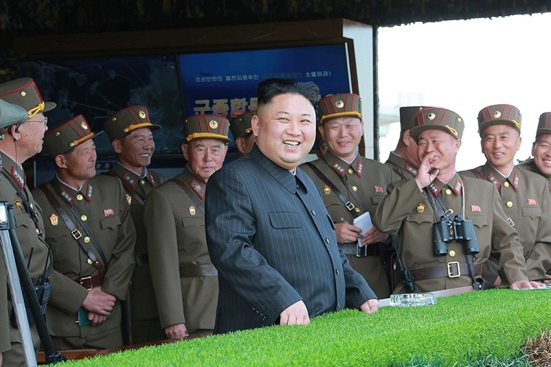 Kim Jong-Un watches a military drill marking the 85th anniversary of the establishment of the Korean People's Army (KPA) in this handout photo by North Korea's Korean Central News Agency (KCNA) made available on April 26, 2017. (Reuters Photo)