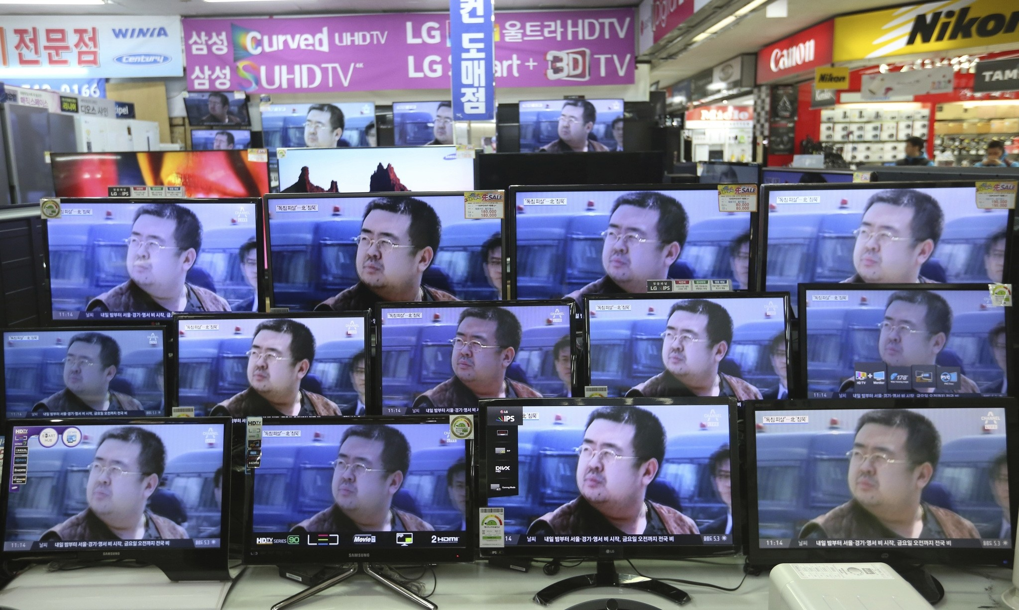 TV screens show pictures of Kim Jong Nam, the half-brother of North Korean leader Kim Jong Un, at an electronic store in Seoul, South Korea, Wednesday, Feb. 15, 2017. (AP Photo)