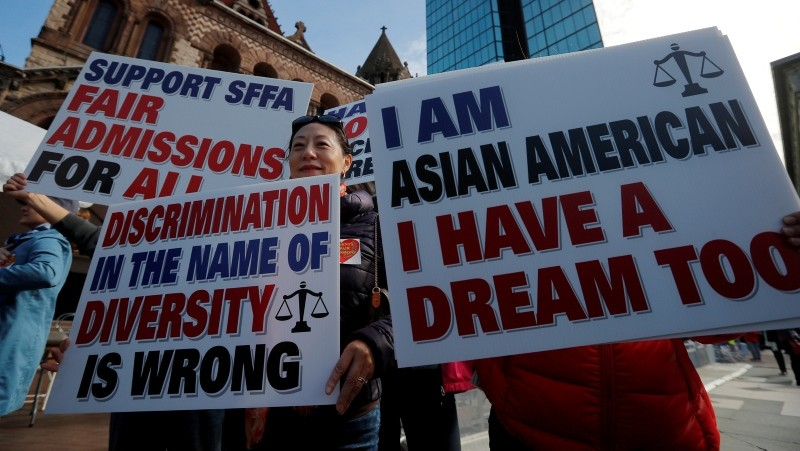 Supporters attend the ,Rally for the American Dream - Equal Education Rights for All,, ahead of the start of the trial in a lawsuit accusing Harvard University of discriminating against Asian applicants in Boston, Oct. 15. (REUTERS Photo)