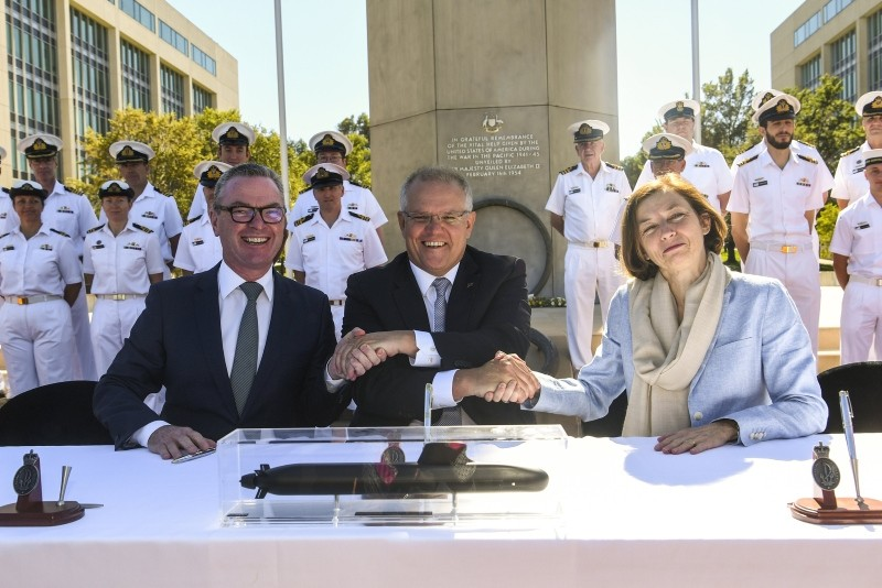 (L-R) Australian Defense Minister Christopher Pyne, PM Scott Morrison and French Defence Minister Florence Parly shake hands after signing Attack class submarine Strategic Partnering Agreement in Canberra, Feb. 11, 2019. (AAP/Lukas Coch via Reuters)
