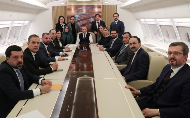 President Recep Tayyip Erdoğan with journalists on his flight from Russia to Turkey, Feb.14, 2019.