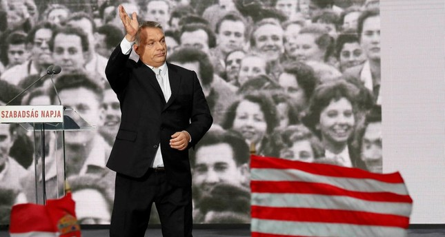 Hungarian Prime Minister Viktor Orban gestures during the celebrations of the 61st anniversary of the Hungarian Uprising of 1956, Budapest, Oct. 23.