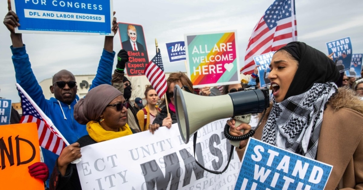 People gather as the Minnesota chapter of the Council on American-Islamic Relations (CAIR-MN) joins a coalition of community organizations in support of Minnesota Representative Ilhan Omar (AFP Photo)