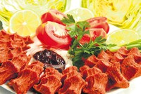 The çiğ köfte, a raw meatball dish, is traditionally made with either lean beef or lamb, kneaded into a dough with bulghur and isot – hot paprika flakes specific to Şanlıurfa –...