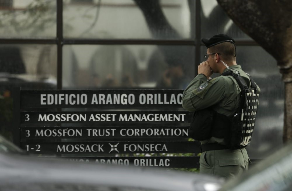 A police officer stands outside the Mossack Fonseca law firm while prosecutors raid the offices in 2016.