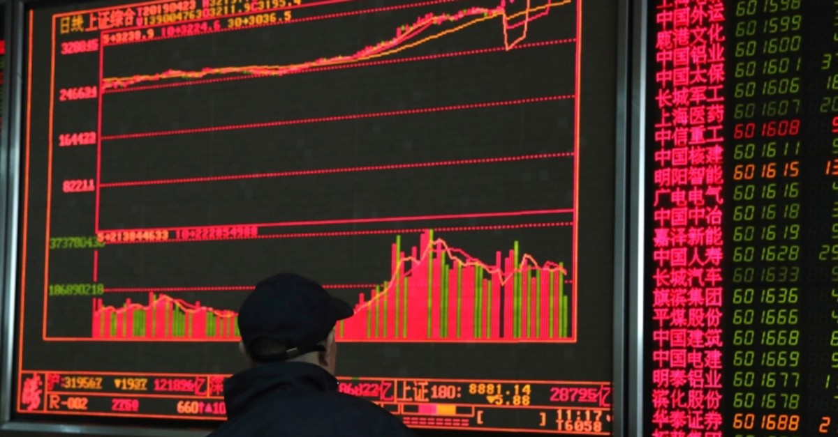 An investor monitors prices at a stock brokerage in Beijing on Tuesday, April 23, 2019. (AP Photo)