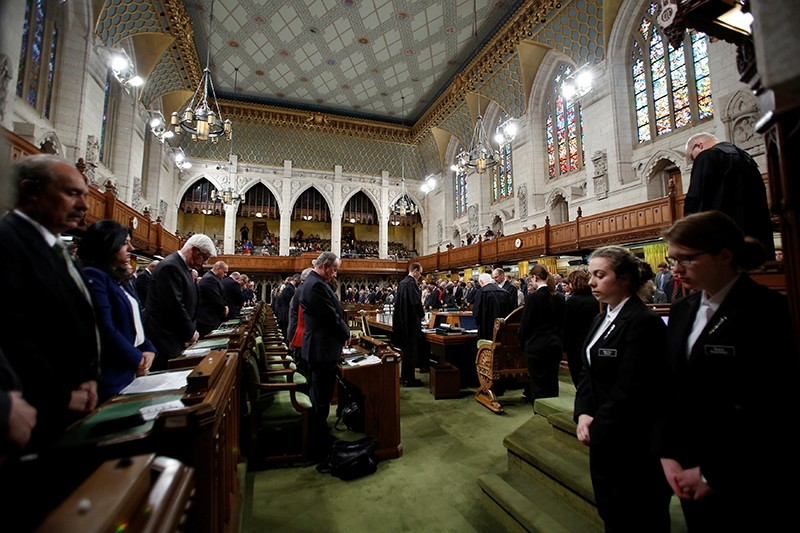 Members of Parliament take part in a moment of silence after party leaders delivered statements on a deadly shooting at a Quebec City mosque (Reuters Photo)