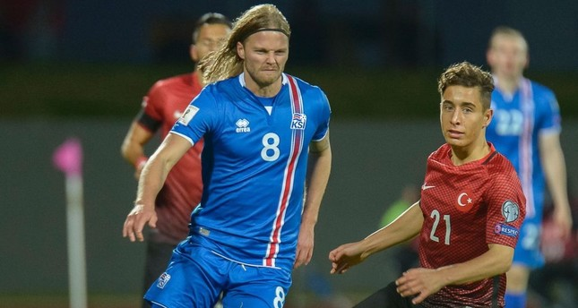 Iceland's midfielder Birkir Bjarnason (L) and Turkey's forward Emre Mor vie for the ball during the 2018 World Cup qualifier football match of Iceland vs Turkey in Reykjavik.