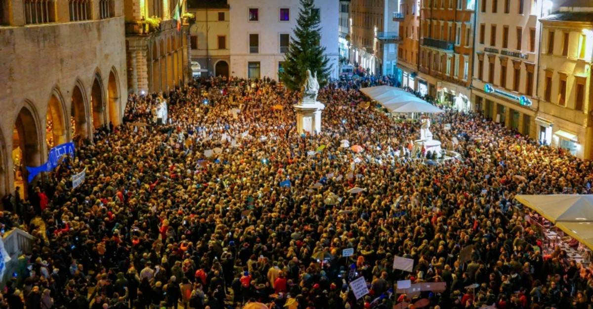 Several thousand demonstrators of the Sardine movement gather in central Rimini to protest against the League's Matteo Salvini, Sunday, Nov. 24, 2019. (AP Photo)