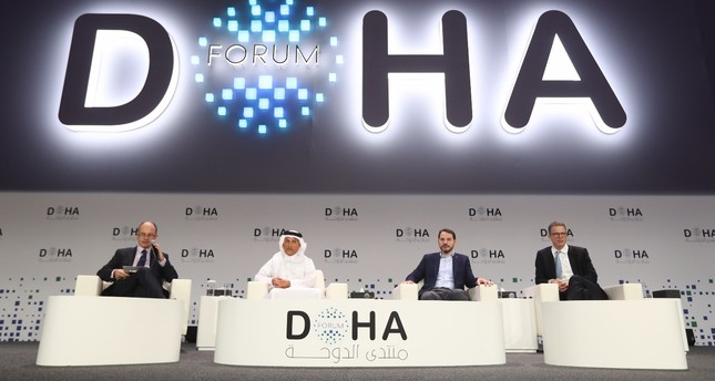 Treasury and Finance Minister Berat Albayrak, right, delivered a speech at the 18th Doha Forum on Saturday.