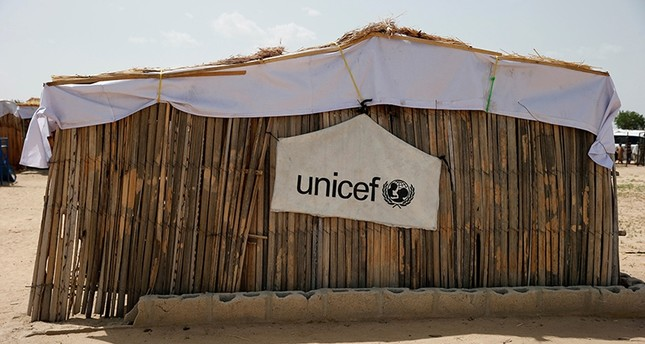 A banner with the UNICEF logo is seen hanging on a makeshift school at an internally displaced persons (IDP) camp on the outskirts of Maiduguri, northeast Nigeria June 6, 2017. (Reuters Photo)