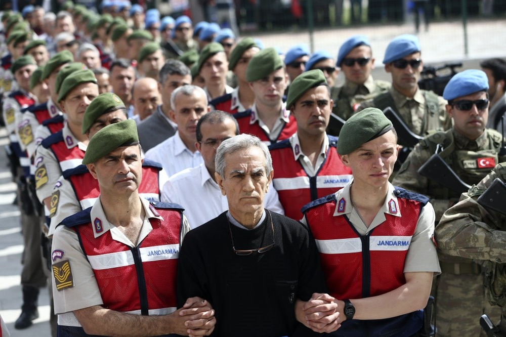 Gendarmerie officers escort generals accused of involvement in last year's coup attempt, to a courtroom in Ankara.