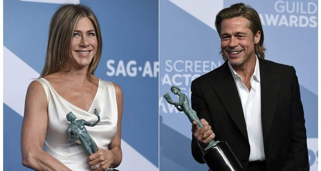 This combination photo shows Jennifer Aniston with the award for outstanding performance by a female actor in a drama series for The Morning Show L and Brad Pitt with the award for outstanding performance by a male actor in a supporting role for Once Upon a Time in Hollywood at the 26th annual Screen Actors Guild Awards on Jan. 19, 2020, in Los Angeles. AP Photo