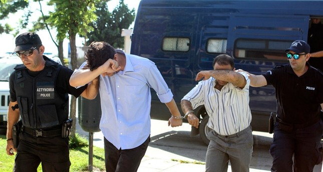 Two of eight Turkish soldiers who fled to Greece in helicopter and requested political asylum after a failed military coup, are brought to prosecutor in Alexandroupolis, Greece July 17, 2016.emREUTERS Photo/em