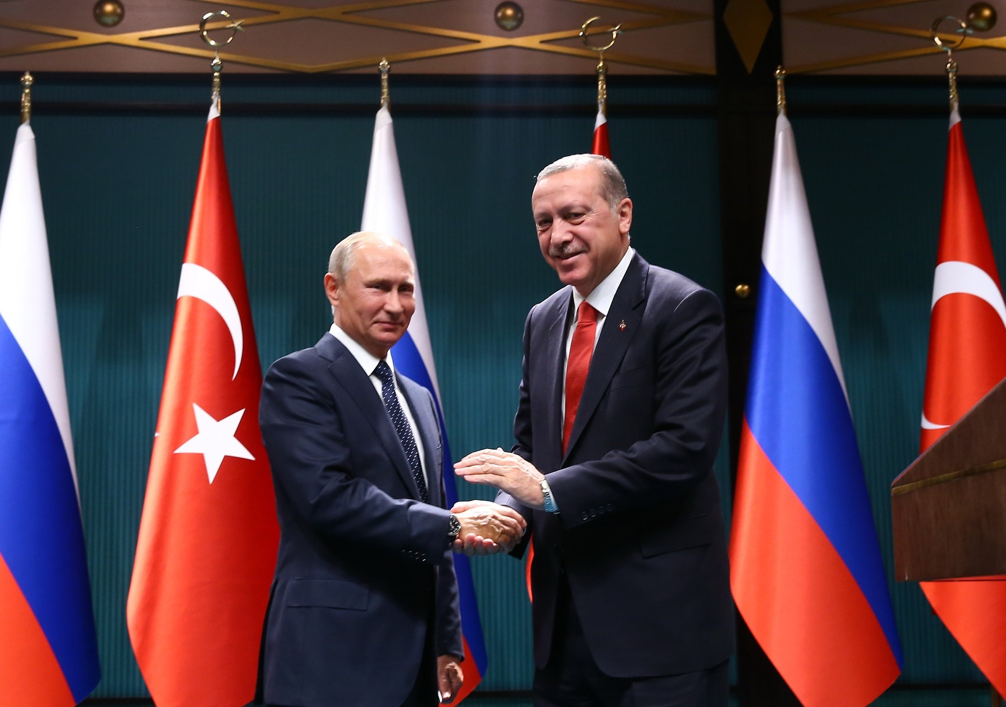 Putin (L) and Erdou011fan (R) shake hands after holding a joint press conference. (FILE Photo)
