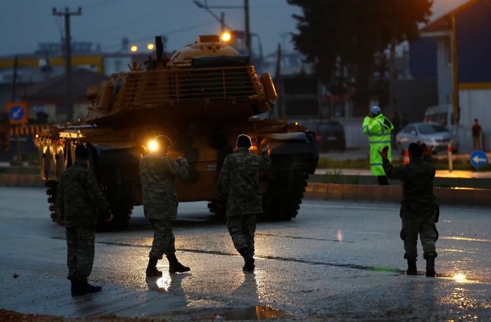 A Turkish military convoy arrives at an army base near the Turkish-Syrian border, Hatay province, Turkey, Jan. 17.