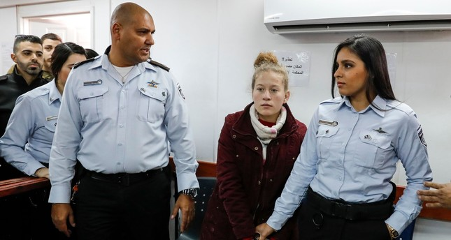 Ahed Tamimi (2nd-R), a 17-year-old prominent Palestinian campaigner against Israel's occupation, appears at a military court at the Israeli-run Ofer prison in the West Bank village of Betunia on December 25, 2017. (AFP Photo)