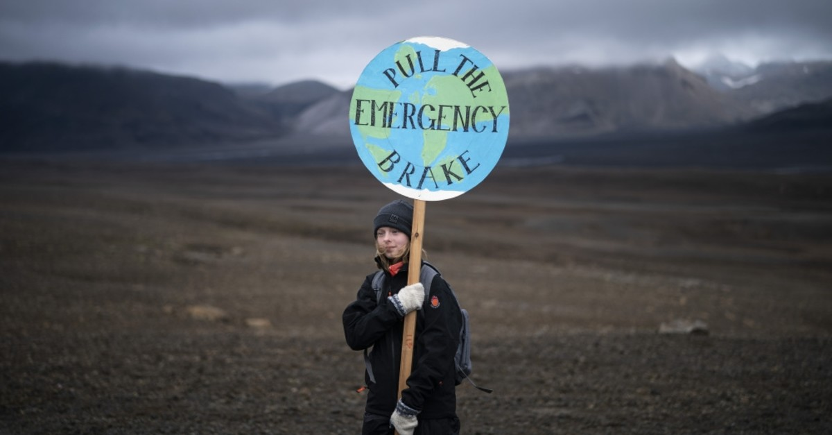 A girl holds a sign that reads ,pull the emergency brake', as she attends the farewell ceremony in Iceland, July 18.