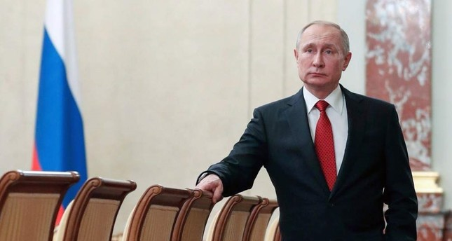 Russian President Vladimir Putin stands prior to a Cabinet meeting, Moscow, Jan. 15, 2020. AP Photo