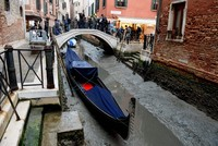 Venice's legendary canals bone dry after low tides, weeks of no rain