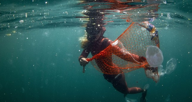 Şahika Ercümen, a world record-holding diver, collects garbage underwater during the launch of the Zero Waste Blue project by Emine Erdoğan in Istanbul, June 11, 2019.