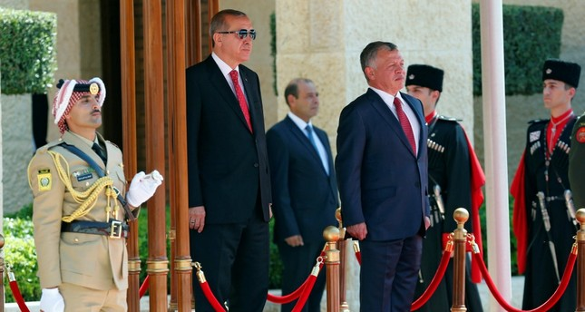 President Erdoğan (L) and Jordan's King Abdullah II (R) review Bedouin honor guards at the Royal Palace in Amman, Jordan, Aug. 21.
