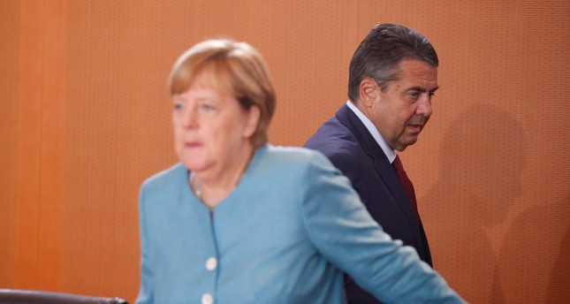 German Foreign Minister Sigmar Gabriel (R) and German Chancellor Angela Merkel attend the weekly cabinet meeting at the Chancellery in Berlin, Germany, Aug. 16.
