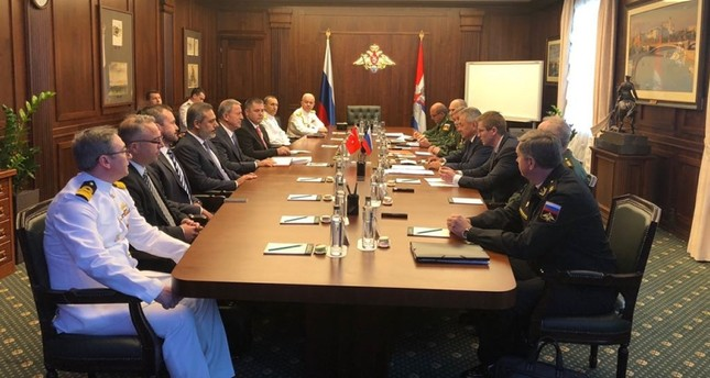 In this August 24, 2018, file photo, Defense Minister Hulusi Akar and Intelligence Chief Hakan Fidan meets with Russian Defense Minister Sergey Shoigu. (AA Photo)