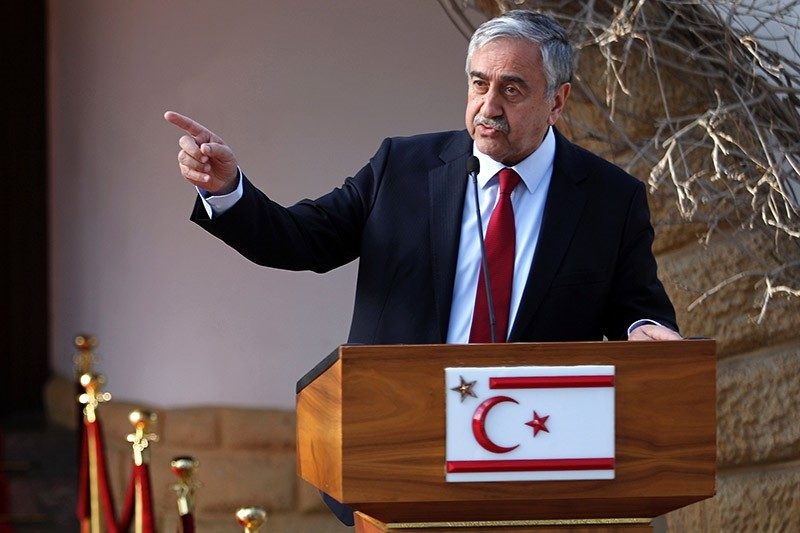 Turkish Cypriot leader Mustafa Aku0131ncu0131 holds a press conference with the Turkish foreign minister after a meeting on February 21, 2017. (AFP Photo)