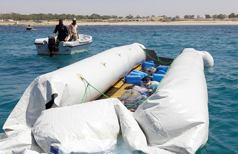 The dead bodies of migrants are seen in a boat off the coast of Gharaboli, east of Tripoli, Libya June 10, 2017. (Reuters Photo)