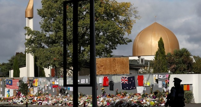 A police officer stands guard outside Al Noor mosque in Christchurch, New Zealand. Reuters Photo