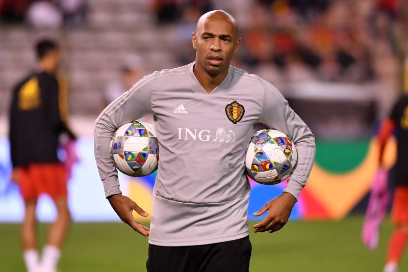 Belgium assistant coach Thierry Henry holds two balls during a warm up prior the UEFA Nations League soccer match between Belgium and Switzerland at the King Baudouin stadium in Brussels, Friday, Oct. 12, 2018. (AP Photo)