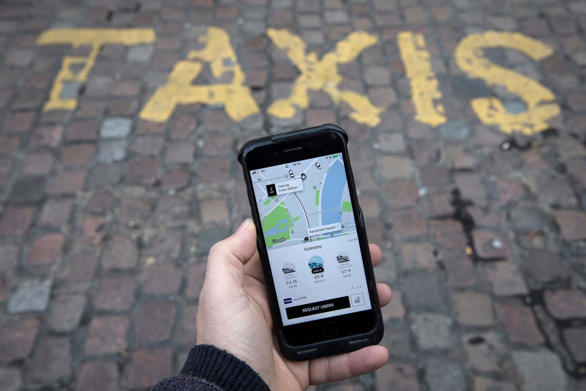 A photo illustration shows the Uber app on a mobile telephone, as it is held up for a posed photograph, in London, Britain, November 10, 2017. (REUTERS Photo)