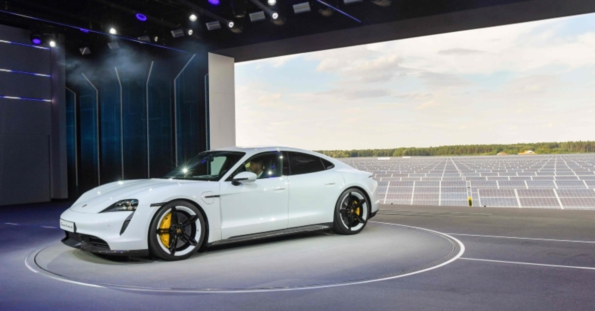 The Porsche Taycan electric car is displayed during the world premiere on September 4, 2019 in a hall of the airfield of Neuhardenberg, in front of a photovoltaic power plant. (AFP Photo)