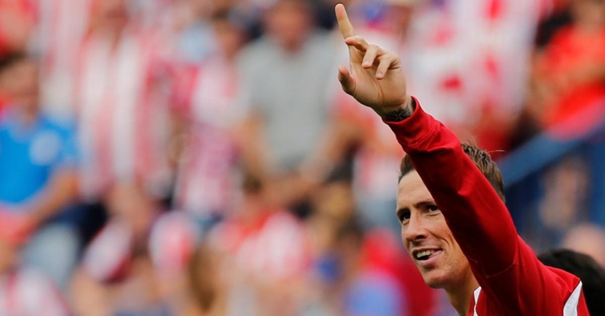 Atletico Madrid's Fernando Torres celebrates a goal. (REUTERS Photo)