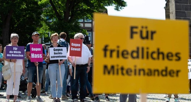 People take part in a vigil against right-wing extremism, Wolfhagen, June 22, 2019.