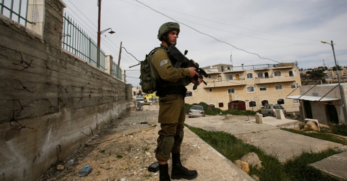 An Israeli soldier stands guard in Hebron, in the occupied West Bank, March 12, 2019. (Reuters Photo)