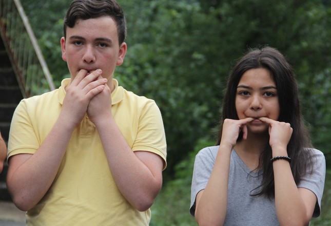 A young man and a woman whistles, something which is considered bad luck in many cultures.
