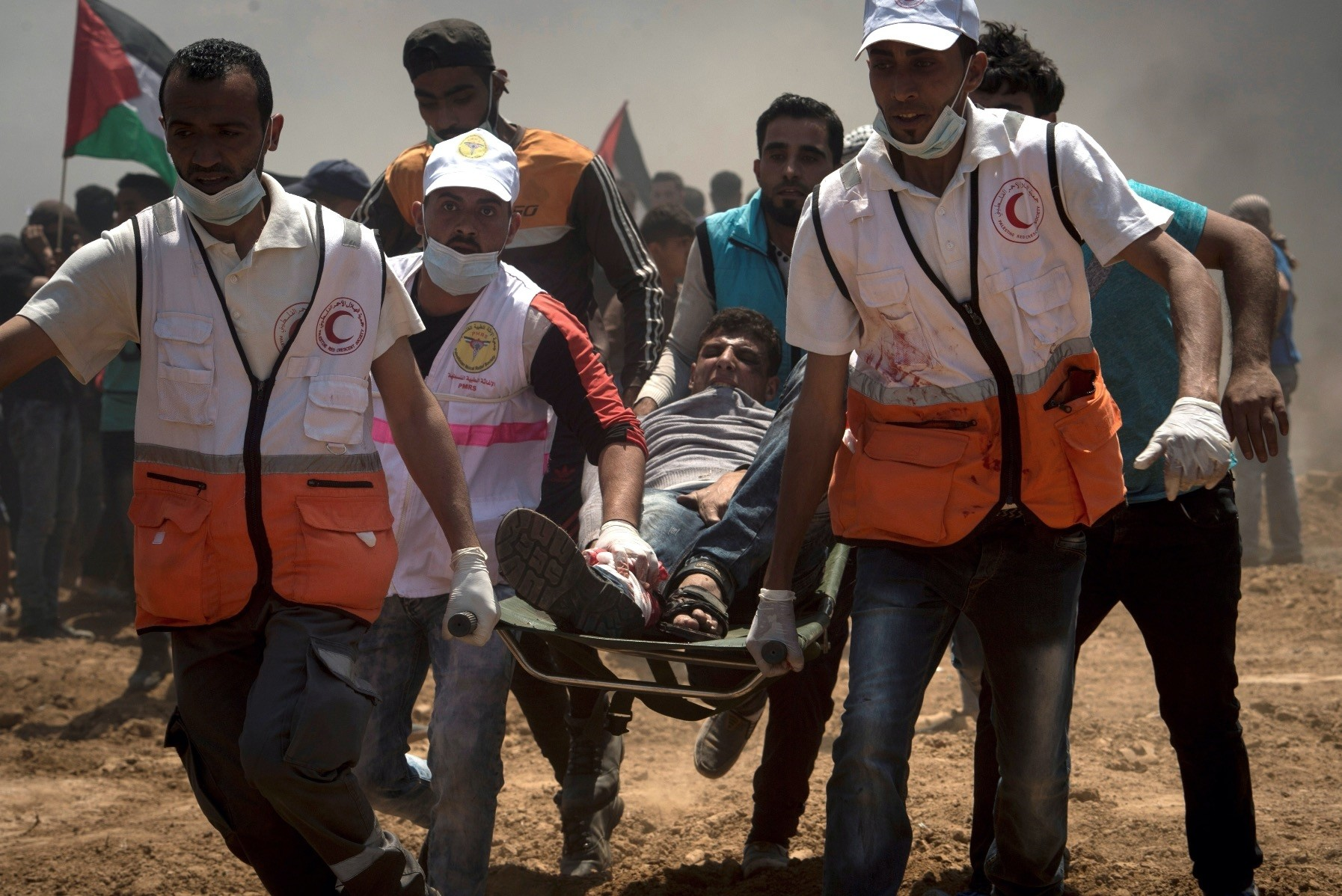 Medics carry a Palestinian demonstrator on a stretcher at the Gaza-Israeli border, May 14.