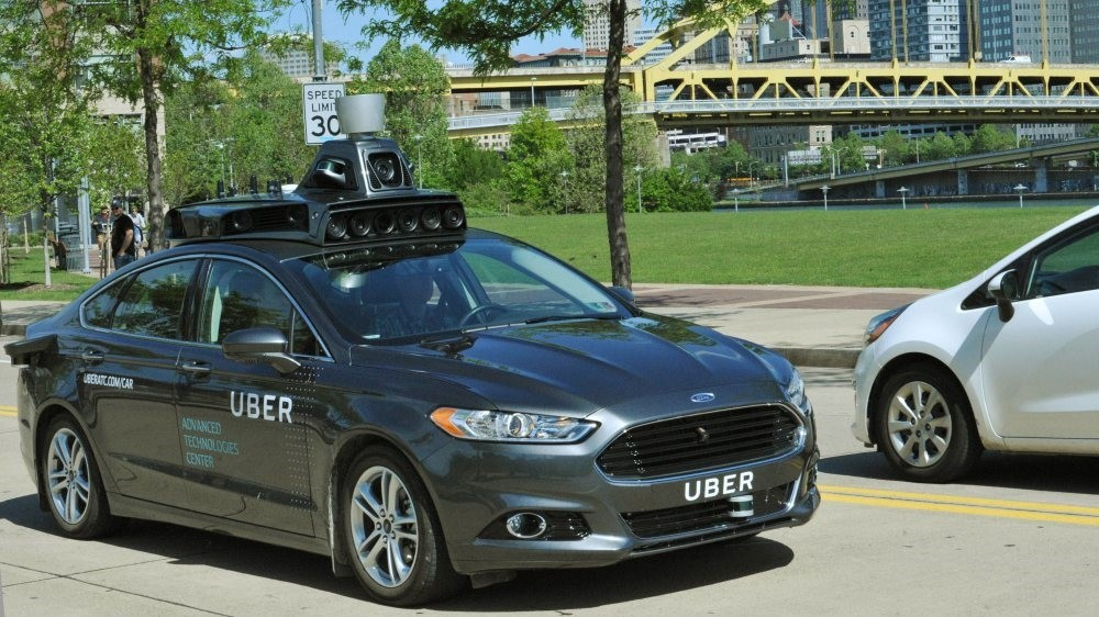 A self-driving car during a test drive in Pittsburgh, Pennsylvania. The car will have multiple sensors, including radars, laser scanners and high-resolution cameras to map details of the environment.