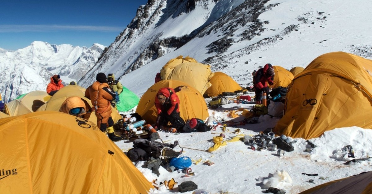 Melting glaciers caused by global warming are exposing trash that has accumulated on the mountain for decades.