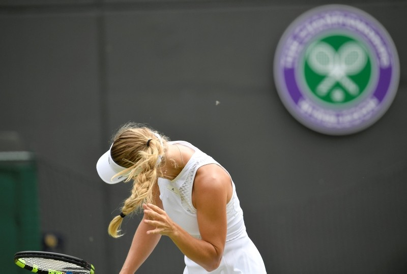 Denmark's Caroline Wozniacki's reacts to flying ants during her second round match against Russia's Ekaterina Makarova. (REUTERS Photo)