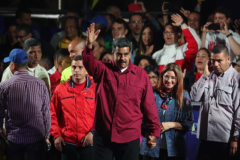 Venezuelan President Nicolas Maduro (C) jubilates his victory with First Lady Cilia Flores (C-R) after the publication of the electoral results in Caracas, Venezuela, May 20, 2018. (EPA Photo)