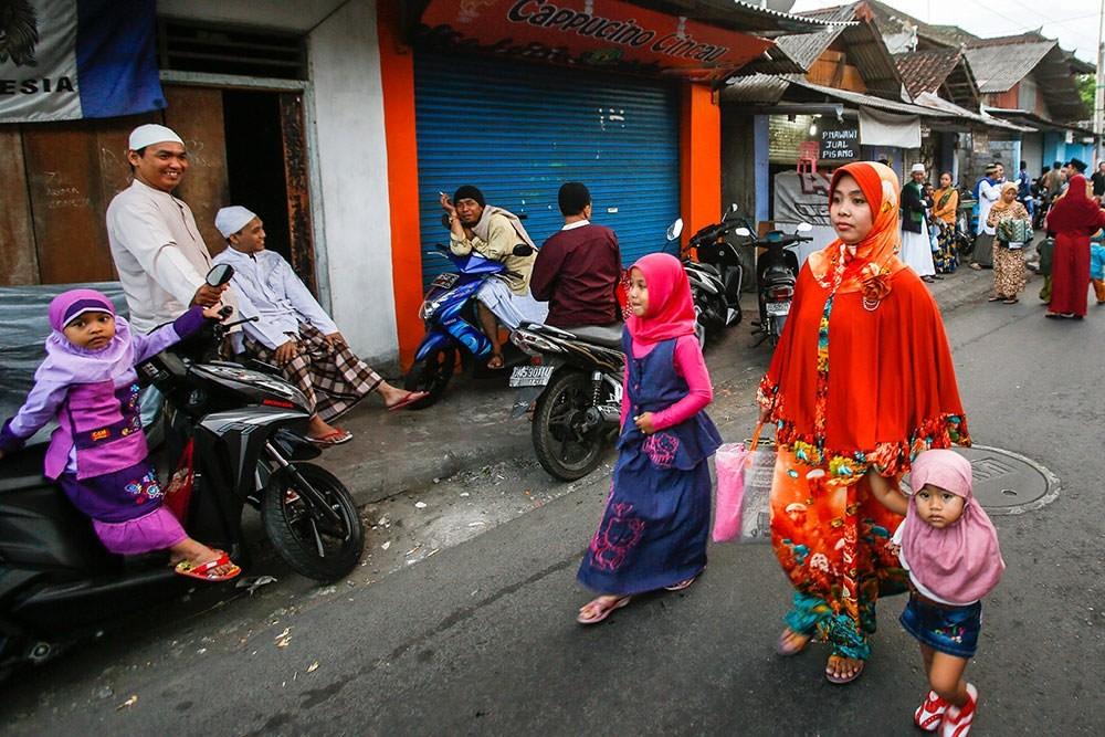 Indonesian Muslims walk to attend mass prayers in Bali, Indonesia