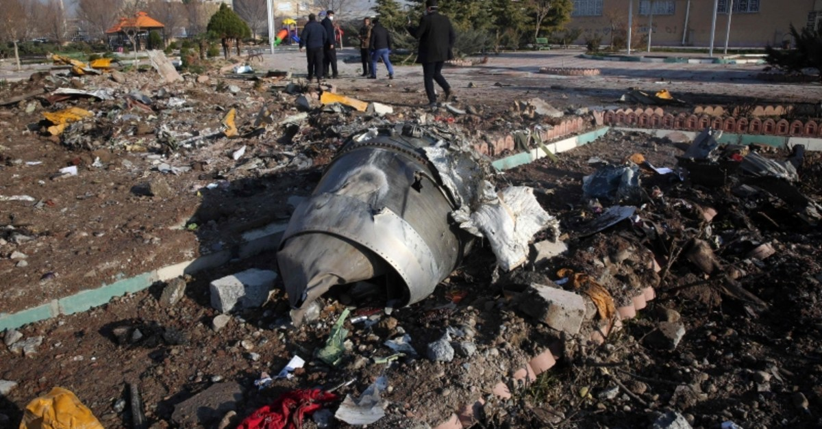Rescue teams work amidst debris after a Ukrainian plane carrying 176 passengers crashed near Imam Khomeini airport in the Iranian capital Tehran early in the morning on January 8, 2020, killing everyone on board. (AFP Photo)