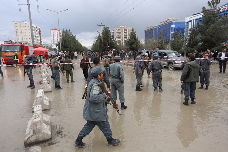 Afghan secuirty forces are seen at the site of an explosion near a gathering of supporters of regional leader Atta Mohammad Noor, in Kabul, Afghanistan, Nov. 16, 2017. (AP Photo)