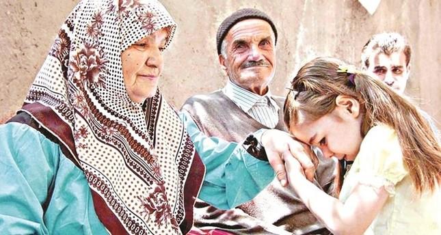 Children kiss the hands of elders to celebrate eid.