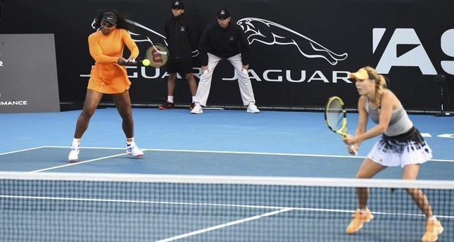 Serena Williams L and Caroline Wozniacki R in action in the match against the Japanese team, Auckland, Jan. 6, 2020. AP Photo