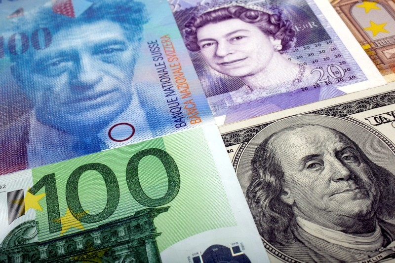 A picture illustration of U.S. dollar, Swiss franc, British pound and Euro bank notes January 26, 2011. (REUTERS Photo)